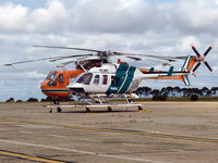VH-BHF @ YMEN - VH-BHF on dolley in front of Sikorsky S64F N197AC, aerial firefighter