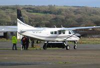 G-SYLV @ EGFH - Skydivers boarding Skydive Swansea's Grand Caravan. - by Roger Winser