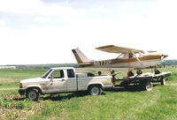 N6772F - Being hauled away to Osceola Iowa to become my first airplane - by Floyd Taber