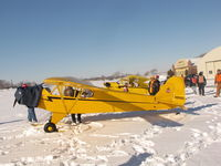 N99165 @ WS17 - Staying warm at Pioneer Airport Ski Plane fly-in - by steveowen