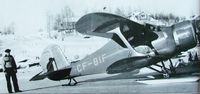 C-FBIF - Don Starratt beside his company's Staggerwing at the foot of 5th Ave in Sioux Lookout, Ontario. Date unknown. Photo courtesy of Don Starratt. - by Stephen B. Nicholson