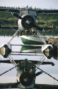 C-GUBS - UBS at the Eagle Air dock, Wollaston Lake, SK, in mid 80's. - by Darrel Giesbrecht (Luke)