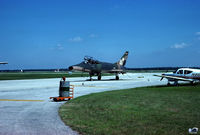 56-3883 @ ACY - Michigan ANG 107th TFS / 127th TFW Super Sabre, with drag chute in tow. - by John Hevesi