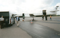G-BUKA @ EGSS - During the Melanie C World Tour 2001 this aircraft was chartered to take us, the Band & Crew, from Stansted, UK to Turku, Finland for the Rock In The Quarry Festival. A journey of around 3 hours either way. Photo: Our gear is being loaded. - by RoadieJohn