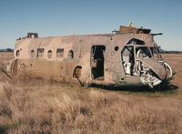 A15-001 - Photograph by Edwin van Opstal with permission. Scanned from a color print. RAAF's first Chinook. Crashed into a dam in 1985. Was recovered and used as a fire training aid at Amberley. - by red750