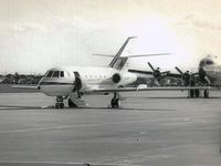 VH-BIZ @ YMEN - This image was scanned from a b&w print taken some time in the early 1960's at Essendon. This was the first business jet in Australia and the only example of the Falcon 20CC built, with dual wheels and low pressure tyres for use on unimproved strips.
