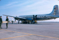 131577 - Members of Inshore Undersea Warfare Group 1 WestPacDet Unit 2 loading aircraft at Naval Air Station, Los Alamitos, Calif. as they deploy to Vietnam in December 1966. - by Unknown