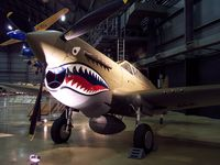 "AK987 @ FFO - This is aircraft is painted to represent the P-40E flown in combat by Bruce Holloway, a pilot in both the Flying Tigers and its successor AAF unit, the 23d Fighter Group.  The aircraft is actually a ""Kittyhawk"" an export version of this Curtiss fighter. - by Ironramper"