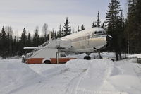 N12347 - This DC6 is located outside Fairbanks AK along a mountain road.  Photo 2/12/12 - by Ken Cochrane