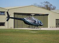 G-LBDC @ EGLD - Bell JetRanger III departing Denham - by moxy