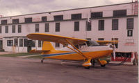 CF-MOA @ CYQF - Spring 1980, Red Deer Alberta. After fuselage recovering, rejuvenated wings, new paint scheme and minor restoration. Only about 1900 hours on it. Original 165 heavy case Franklin overhauled a couple of years before purchase but still '0' time. - by Regan