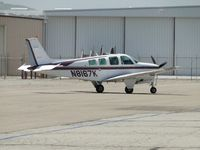 N8167K @ CNO - Taxiing towards the fuel pump area, passing Yank's backyard - by Helicopterfriend