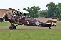 N9125 @ FA08 - 1931 White NEW STANDARD D-25A, c/n: 205 giving pleasure rides at Fantasy of Flight Museum , Polk City FL