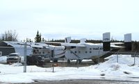 C-GTBU @ CYXY - Newly arrived in Whitehorse - not a good photo but I'll watch for a better op. The Short in front is N754BD. - by Murray Lundberg