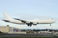A6-PFA @ PAE - Typical. A bank of cloud ruins this test flight landing shot! - by Duncan Kirk