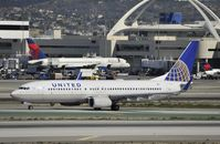 N14231 @ KLAX - Taxiing to gate at LAX - by Todd Royer