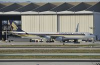9V-SGD @ KLAX - Taxiing to gate at LAX - by Todd Royer