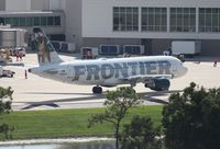 N214FR @ MCO - Frontier Carl the Coyote A320