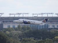 N87555 @ TPA - Continental Connection B1900D in front of Raymond James Stadium
