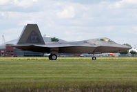08-4166 @ LFI - 2010 Block 35 F-22A Raptor 08-4166 with the 94th FS Spads taxiing to the ramp after landing on RWY 26. - by Dean Heald