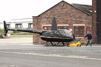 G-CFNF @ EGCB - Robinson R44 Raven II, c/n: 12496 at City of Manchester Airport