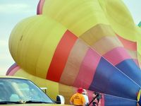 N4134G @ LAL - The wind was too strong to allow the full inflation and mass take-off of the balloons at 2012 Sun n Fun