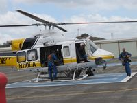 N110LA @ POC - Personnel putting on their lift harnesses for a call out - by Helicopterfriend