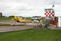 G-IIAI @ EGBR - Mudry CAP 232 at the pump, Breighton Airfield, April 2011. - by Malcolm Clarke