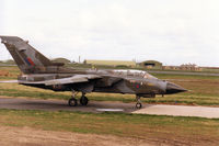 ZA599 @ EGQS - Tornado GR.1 of 12 Squadron taxying to Runway 05 at RAF Lossiemouth in April 1996 and wearing traces of the previous unit markings of the Tri-National Tornado Training Establishment on the fin. - by Peter Nicholson