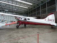 G-DHCZ @ IWM - Standing in a hanger at IWM Duxford - by Lawrence Wright