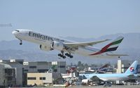 A6-EWE @ KLAX - Departing LAX on 25R - by Todd Royer
