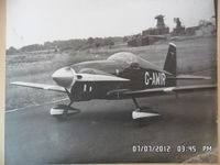 G-AWIR @ EGBG - the owner and builder Ken Sword taxying from the hangar at leicester where it was built and based .picture is of a B&W print i have at home  - by Ken Sword jnr