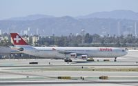 HB-JMA @ KLAX - Taxiing to gate at LAX