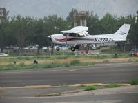 N137RJ @ POC - Gusting winds giving student pilot some training corrections for landind - by Helicopterfriend