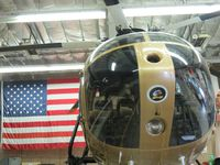 N108PP @ POC - Parked in her hanger by her flag - by Helicopterfriend