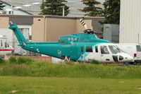 B-HJR @ CYYC - Ex Hong Kong Registered Sikorsky S-76C+, c/n: 760497 at Eagle Helicopters at Calgary - by Terry Fletcher