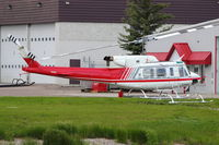 C-FALK @ CYYC - Bell 212, c/n: 30982 at Calgary - by Terry Fletcher