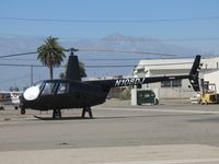 N108DJ @ CNO - Parked with a sunshade partially blocking the sun - by Helicopterfriend