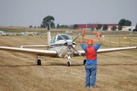 N98MW @ KOSH - Taxiing out for departure at Oshkosh on 25 July 2012. - by Glenn Beltz