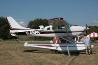 C-GNPN @ OSH - 1981 Cessna TU206G, c/n: U20606194 - by Timothy Aanerud