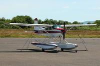 N185GG @ AST - 1975 Cessna A185F, c/n: 18502787 - by Terry Fletcher