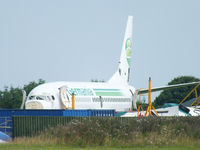 D-AGEG @ EGBP - Germania B737 in the scrapping area at Kemble - by Chris Hall
