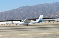 N67SS @ CCB - Main gear down, nose wheel coming down on runway 24