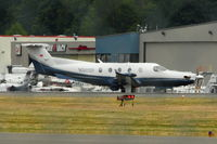 N505P @ BFI - 2003 Pilatus PC-12/45, c/n: 505 through the heat haze at BFI