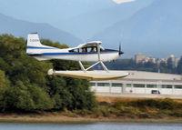 C-GZDN @ CYVR - Landing - by Guy Pambrun