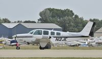 N12JE @ KOSH - Arriving at Airventure on runway 27 - by Todd Royer