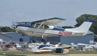N210RR @ KOSH - Departing Airventure on runway 27