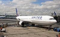 N667UA @ KEWR - A newly repainted UA 767-322/ER awaits its next journey on a stormy day at Newark. - by Daniel L. Berek
