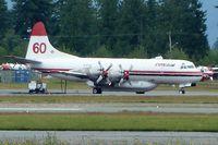 C-FYYJ @ CYXX - Conair 1961 Lockheed 188A, c/n: 1143 - by Terry Fletcher