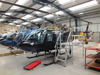 G-OMDR @ EGBS - inside the Tiger Helicopter's Hangar at Shobdon Airfield, Herefordshire - by Chris Hall